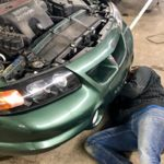 person working on car